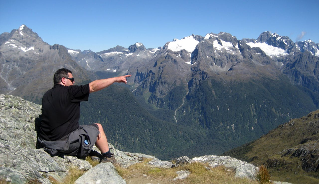 New Zealand peak bagging instigator Jon Povey enjoys the top of Conical Hill, off the Routeburn Track in Fiordland. Photo: Julia Becker