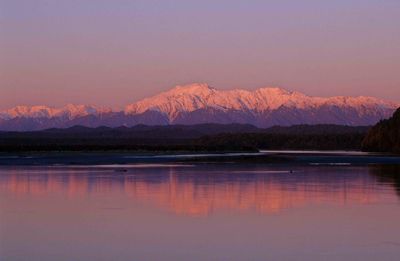 Views of the Alps from Okarito Lagoon. Photo: Steve Baker