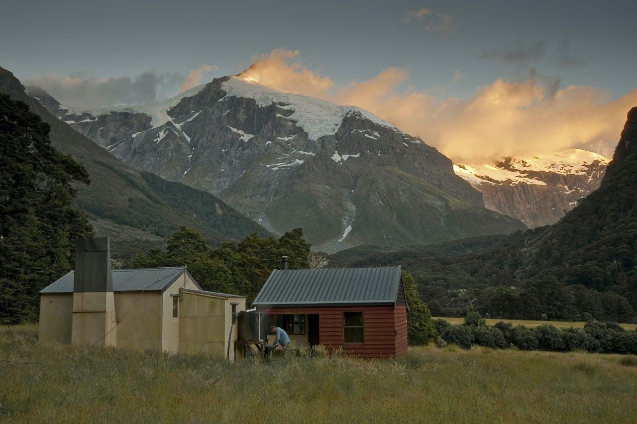 Top Forks Hut with dawn light on Mt Pollux. Photo: Shaun Barnett