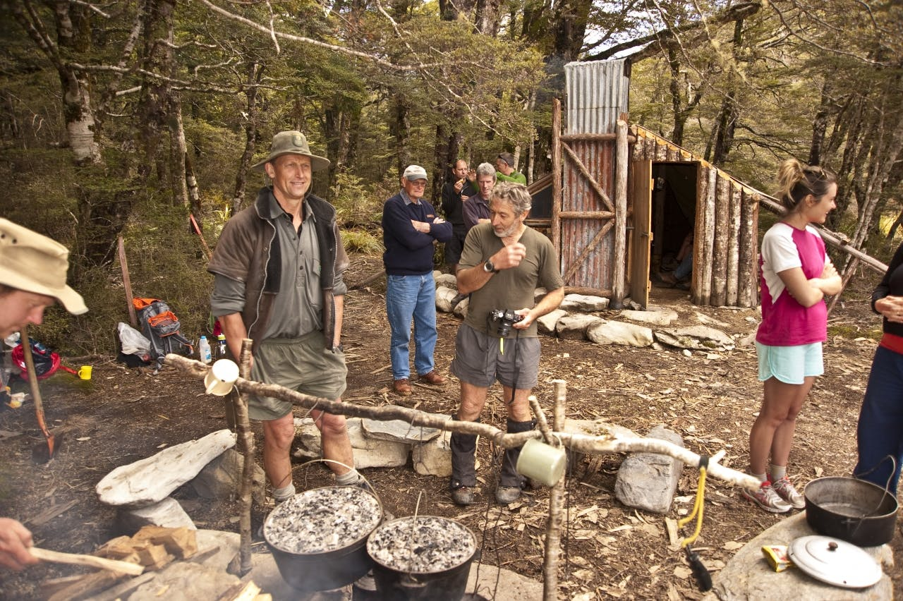 John Taylor and Geoff Spearpoint prepare camp oven scones. Photo: Shaun Barnett/Black Robin Photography
