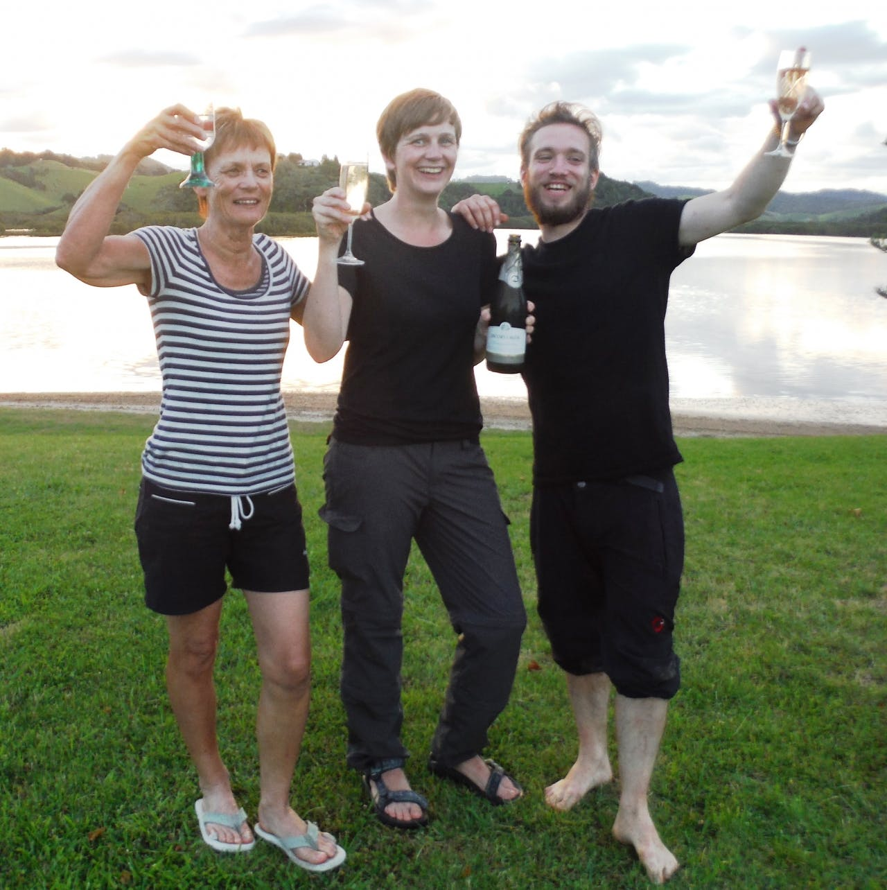 Trampers Helen, Hana and Simon were treated to a bottle of champagne to celebrate Whananaki Holiday Park's 100th TA.