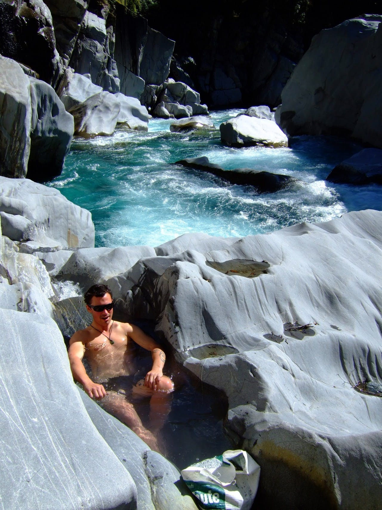 Soaking weary muscles in a hotpool, like this one on the Waitaha River, is one of life's joys. Photo: Sally Jackson
