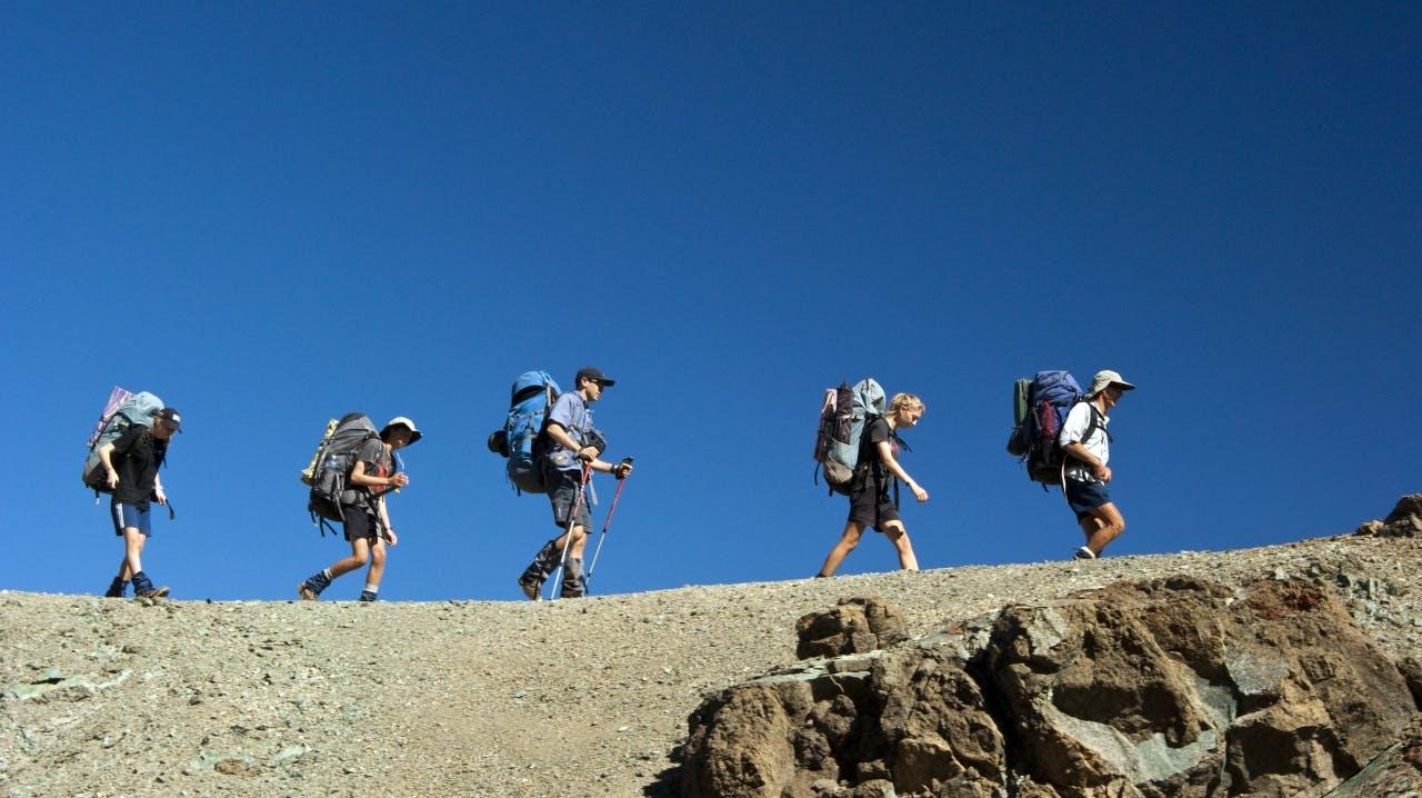 Traversing a narrow ridgeline en route to Hunters Hut
