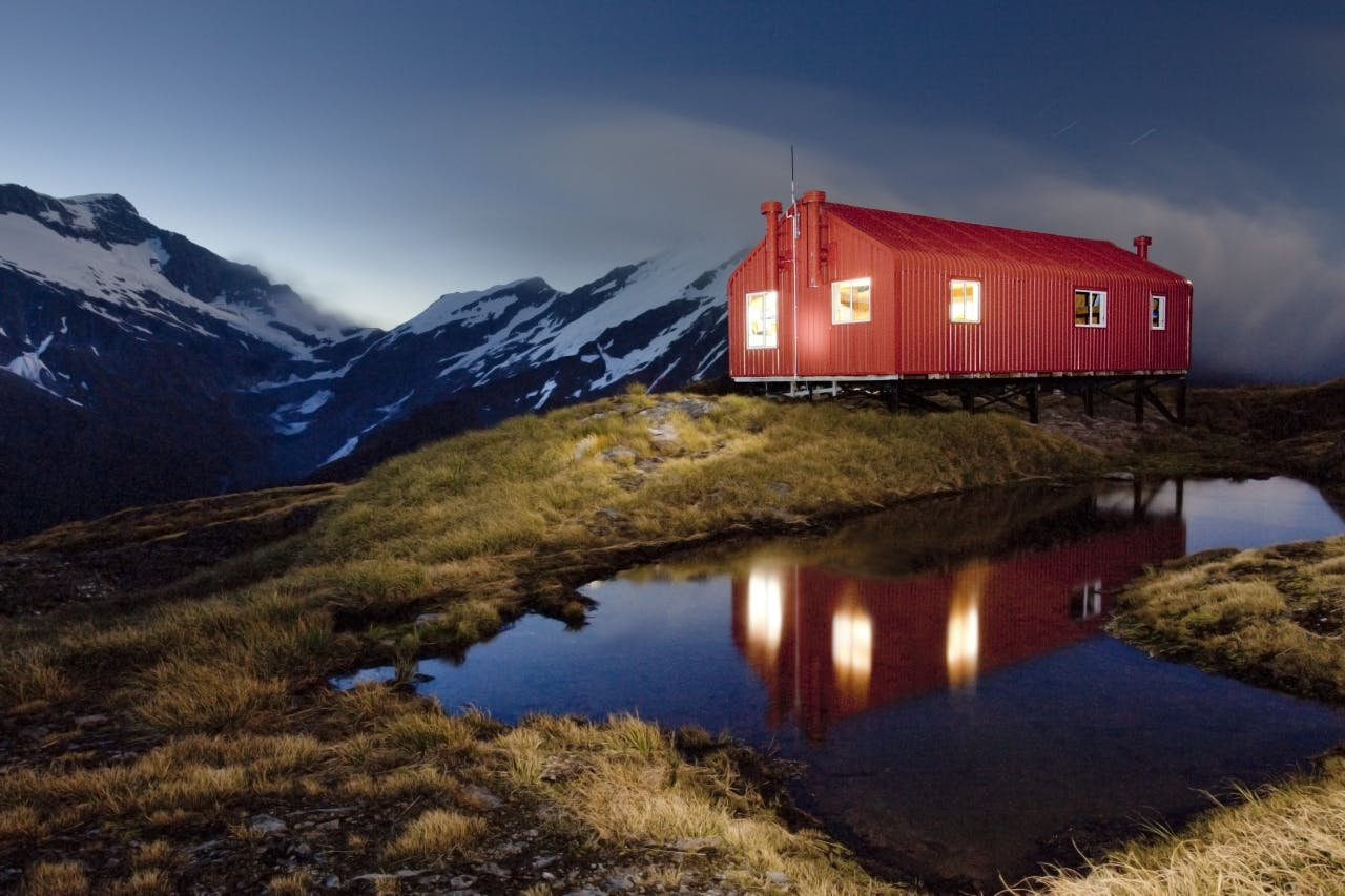 A torch is used to paint French Ridge Hut in light. Photo: Ray Salisbury