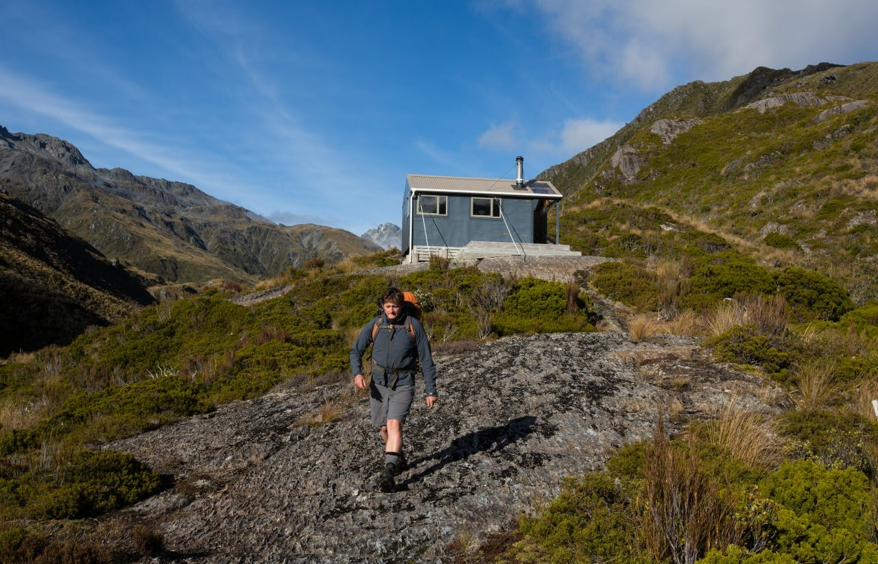 Leaving the comfort of bluff hut in rare sunshine.