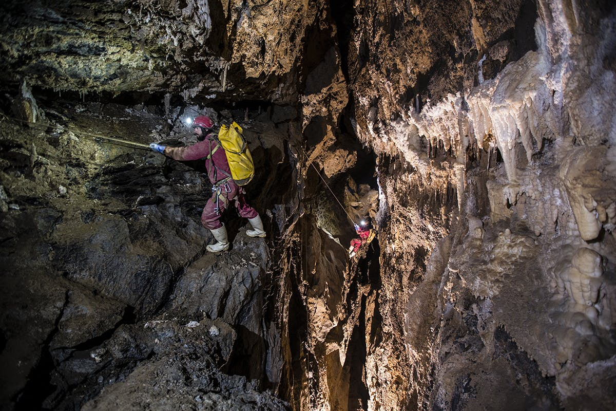 Cavers follow traverse lines across the intimidating 'Who Dares Wins' climb near the end of Bulmer. Photo: Neil Silverwood