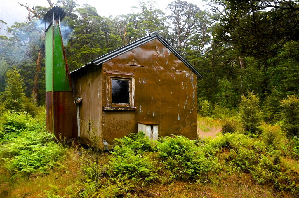 Lake Te Au Hut was built in 1963. It is the best preserved NZFS hut in the Murchisons. It was used for deer control and takahe work. It features three 'bush' chairs made from packing case timbers. Photo: Carl Walrond