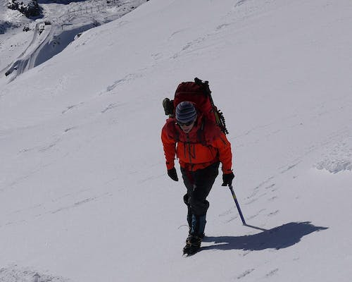 When traversing slopes, roll your ankle to ensure all points of the crampon contact the surface