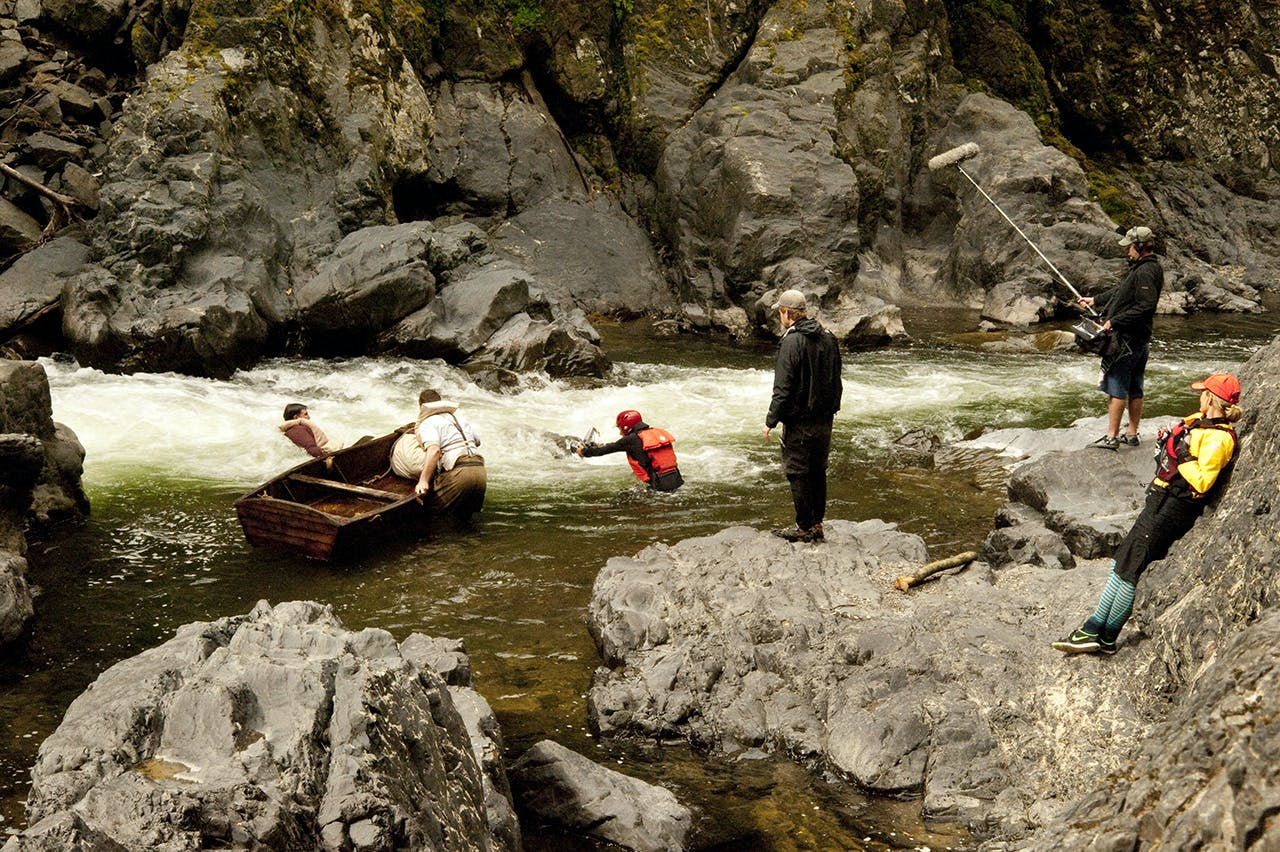 The film crew watch as Kevin and Jamie capsize their punt on the Motu River. Photo: Shaun Barnett/Black Robin Photography