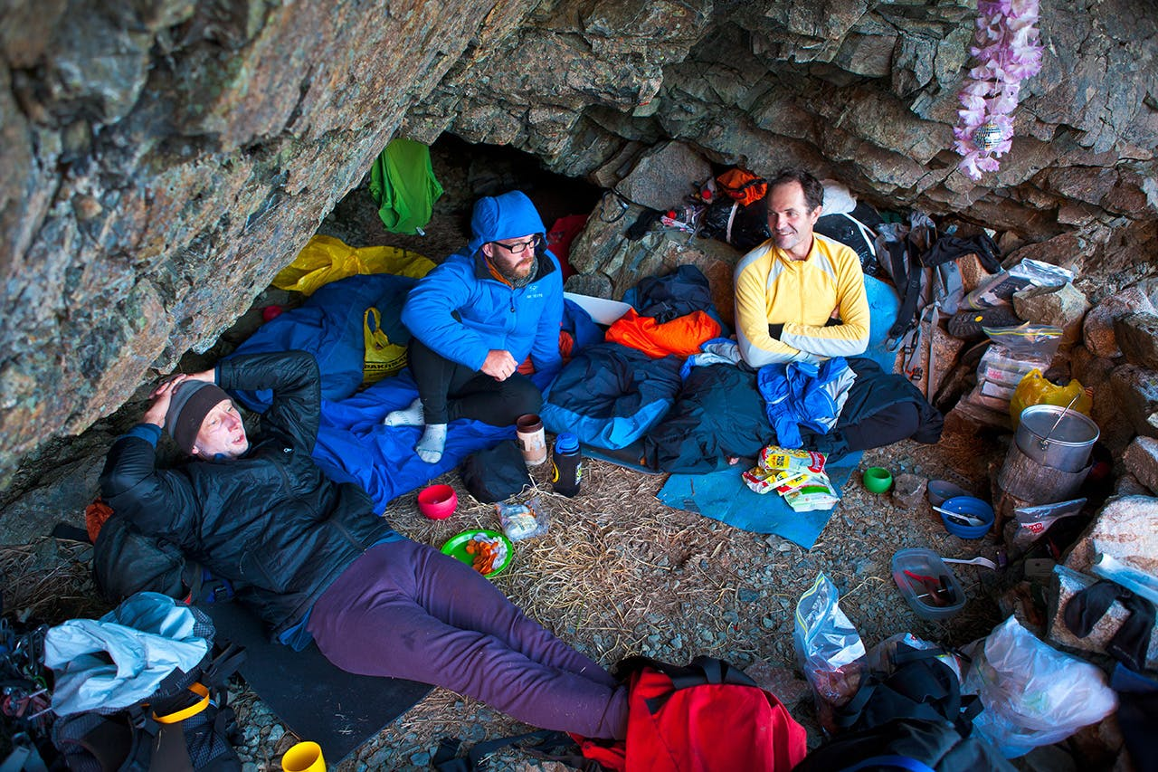 Climbers rest at their rock bivvy after a day climbing in the Darran Mountains – the new centre of NZ climbing. Photo: Mark Watson
