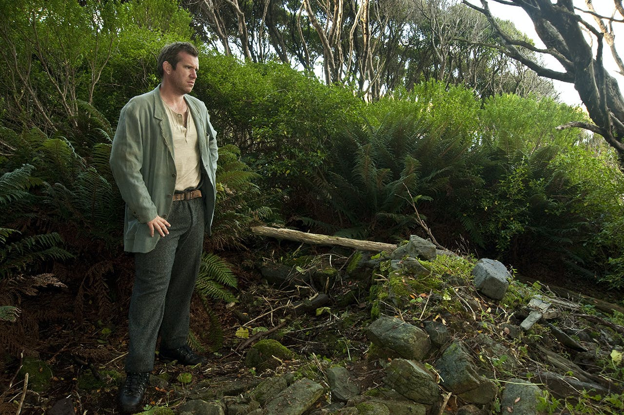 Jamie Fitzgerald at the ruins of Epigwaitt Hut on the Auckland Islands. photo: Shaun Barnett