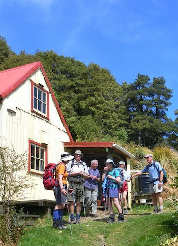 Lunch over, trampers at field hut prepare to head back down the track