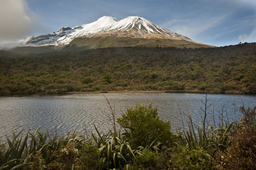 Mt Taranaki and Fanthams Peak from Lake Dive. Photo: Shaun Barnett/Black Robin Photography