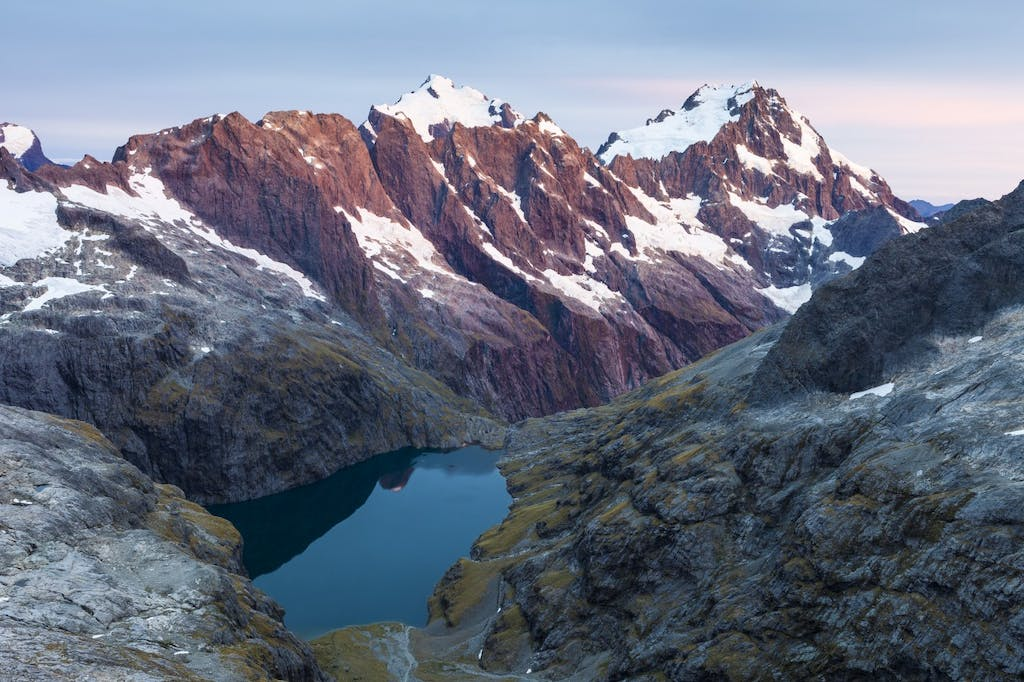 Lake Turner with the Central Darrans peaks of Makere, Tarewai, Milne, Tutoko and Madeline beyond. Photo: Mark Watson