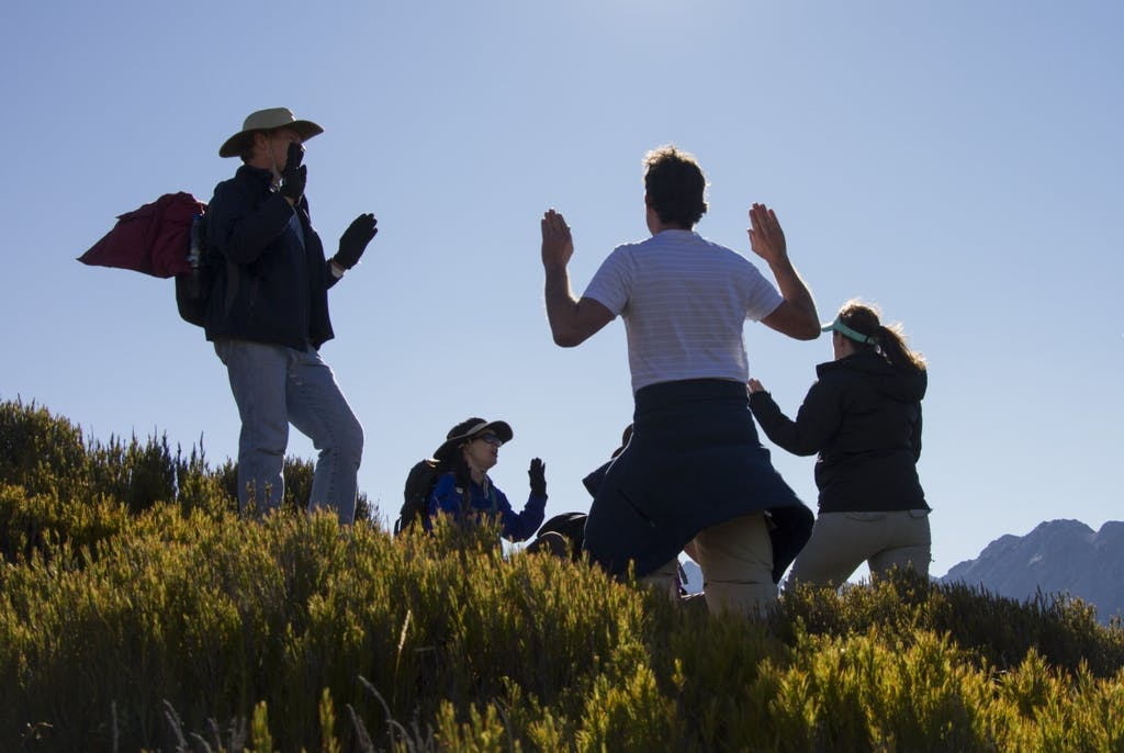 Members of the Aetherius Society pray part way up Mt Wakefield. Photo: Anna Pearson