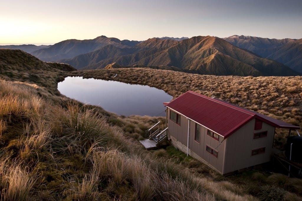 Maungahuka Hut and tarn. Photo: Shaun Barnett/Black Robin Photography