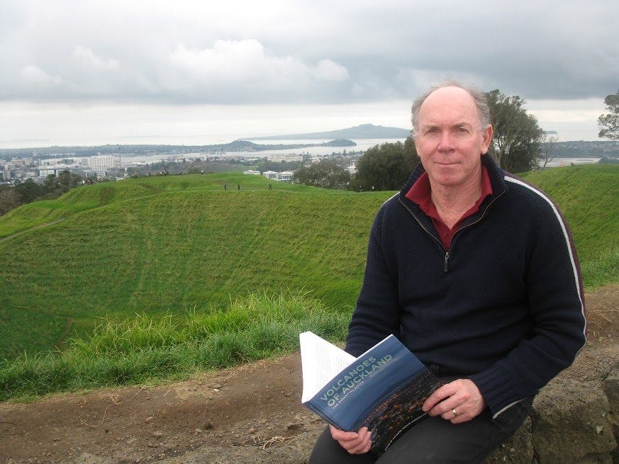 Geologist Bruce Hayward with one of his books, Volcanoes of Auckland. Photo: Matthew Pike