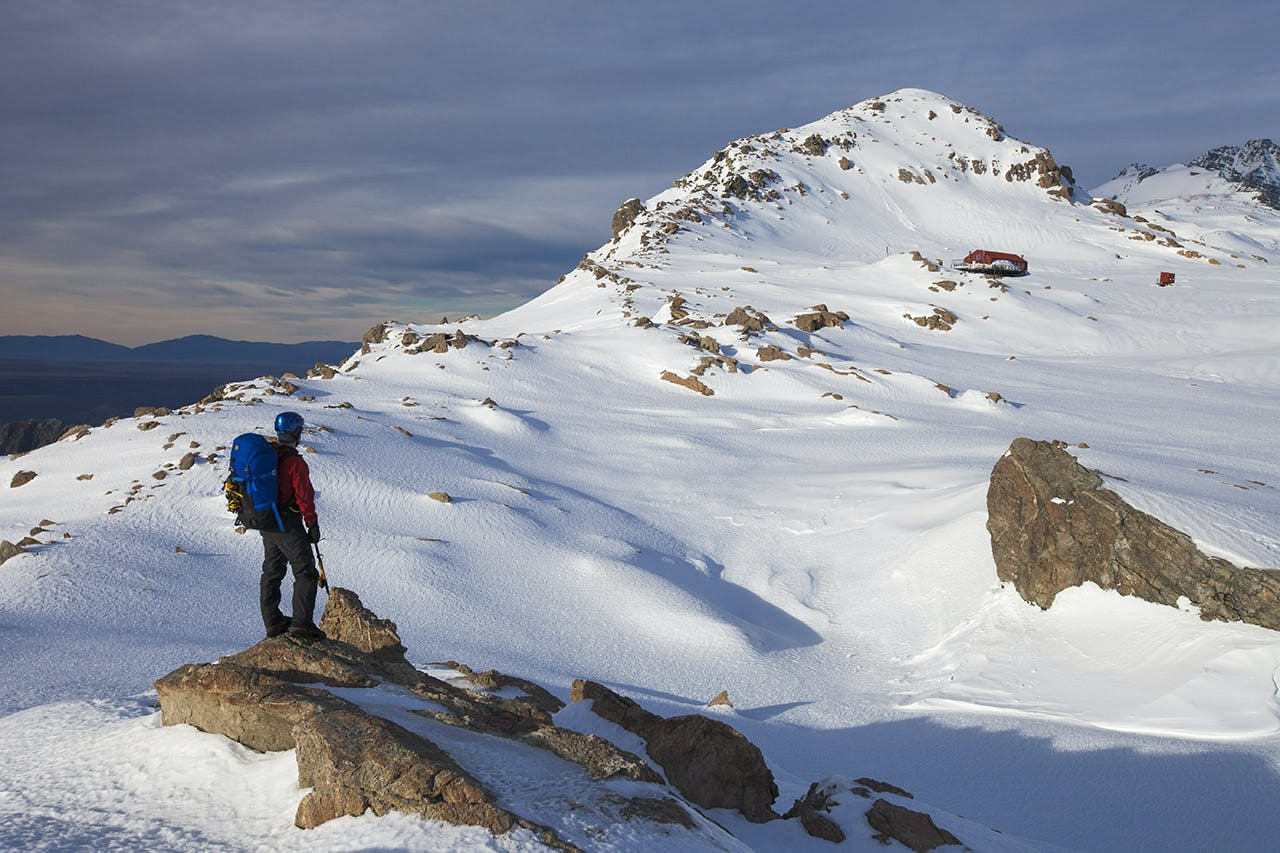 Mt Ollivier stands high over Mueller Hut – a great sight after a steep climb from the valley. Photo: Mark Watson