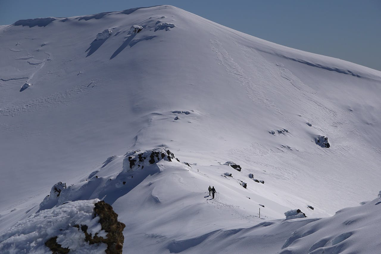 Trampers on the ridge leading to Mt Tongariro. Photo: Alistair Hall
