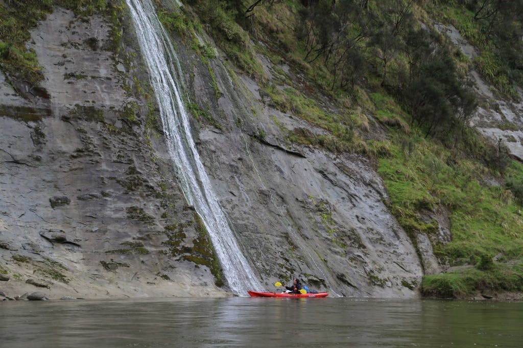 A kayaker goes for a shower south of Whakahoro . Photo: Matthew Pike