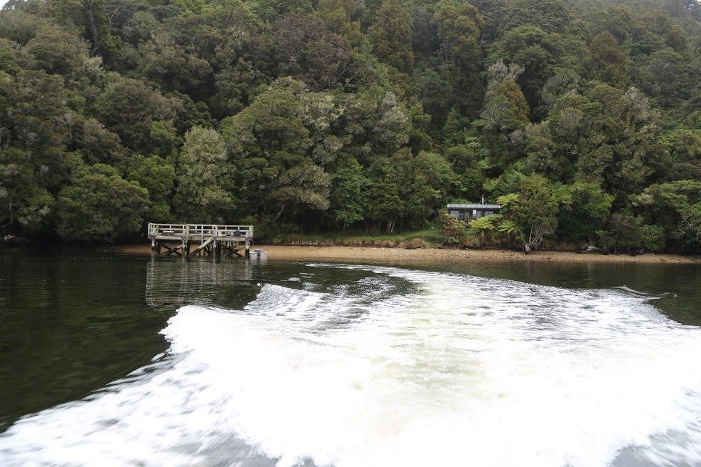 Leaving Freds Camp Hut by water taxi. Photo: Alistair Hall