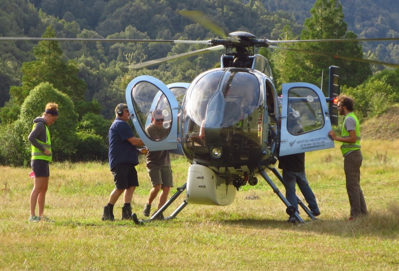 Boarding a helicopter in preparation for a flight to Te Pua Hut.