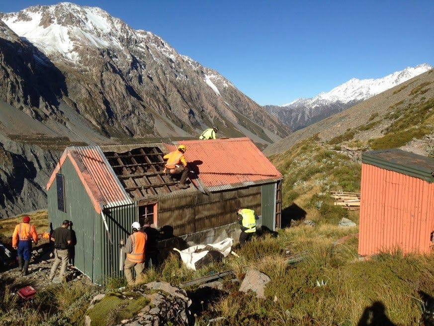 Hooker Hut being dismantled before being removed. Photo: DOC
