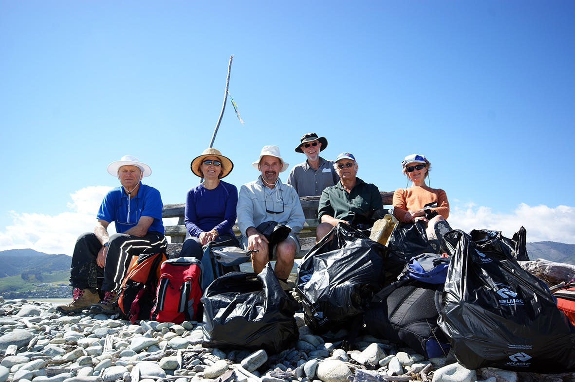 Volunteers from a tramping club fill bags of debri on Nelson's Boulder Bank. Photo: Ray Salisbury