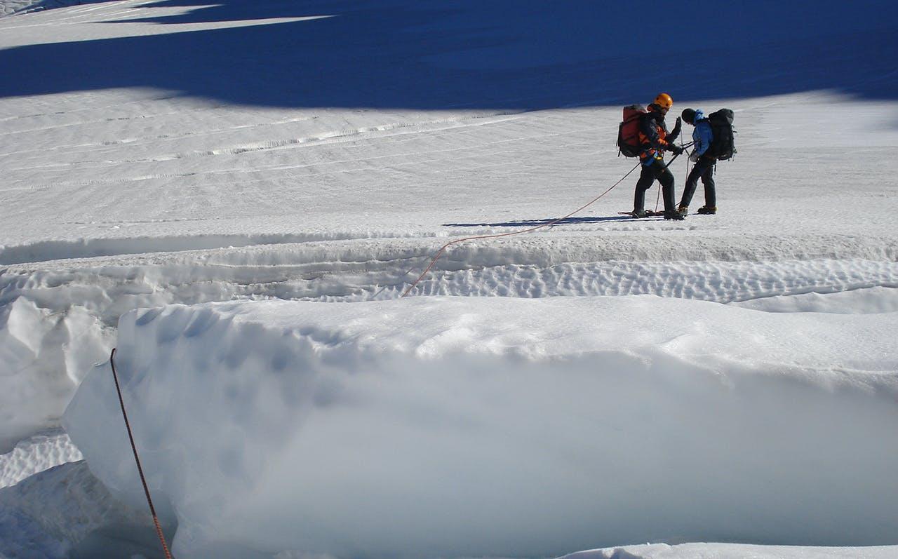 Negotiating a large crevasse. Photo: Nick Ross
