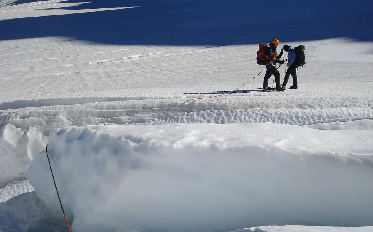 Negotiating a large crevasse. Photo: Nick Ross