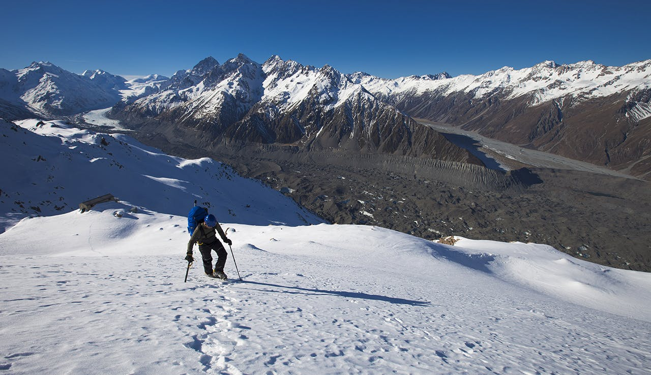 Climbing to Ball Pass, just above Caroline Hut, Tasman Glacier and Malte Brun Range in background. Photo: Mark Watson