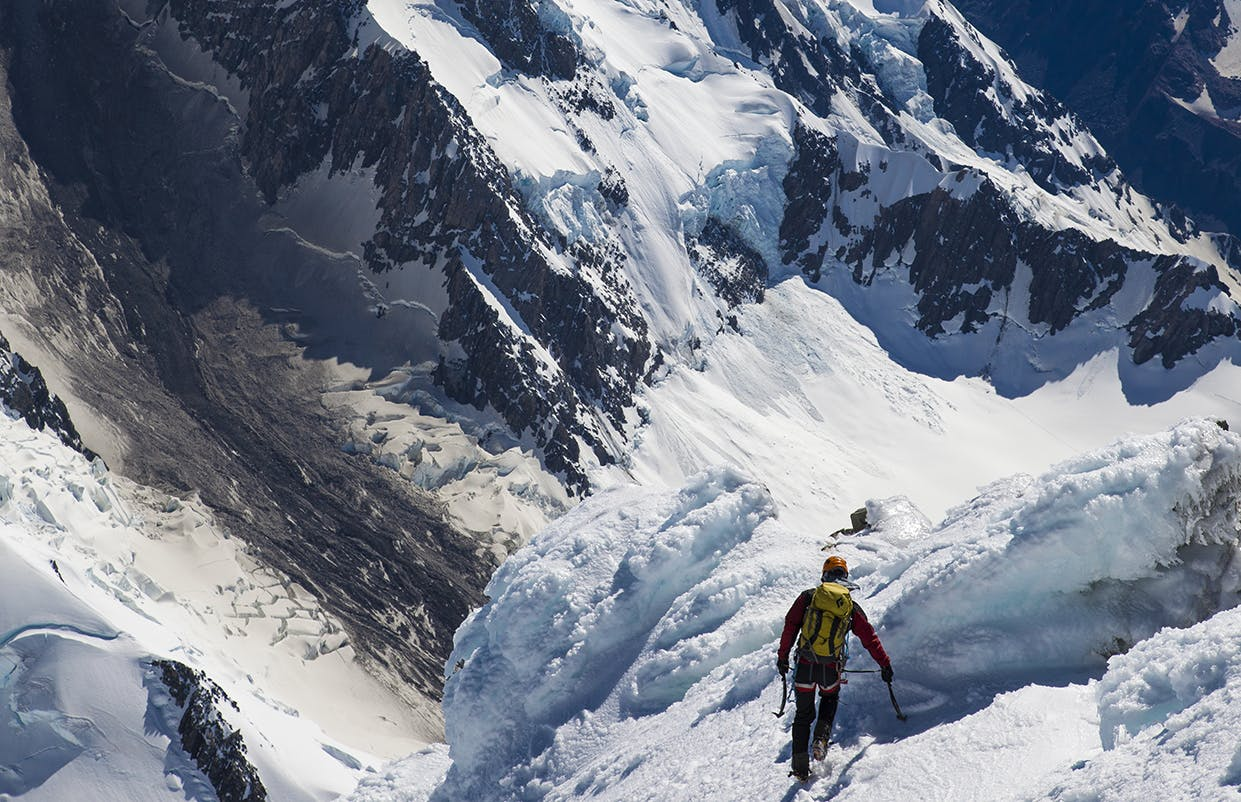 Descending the summit icecap of Aoraki/Mt Cook with the Haast avalanche scar far below. Photo: Mark Watson