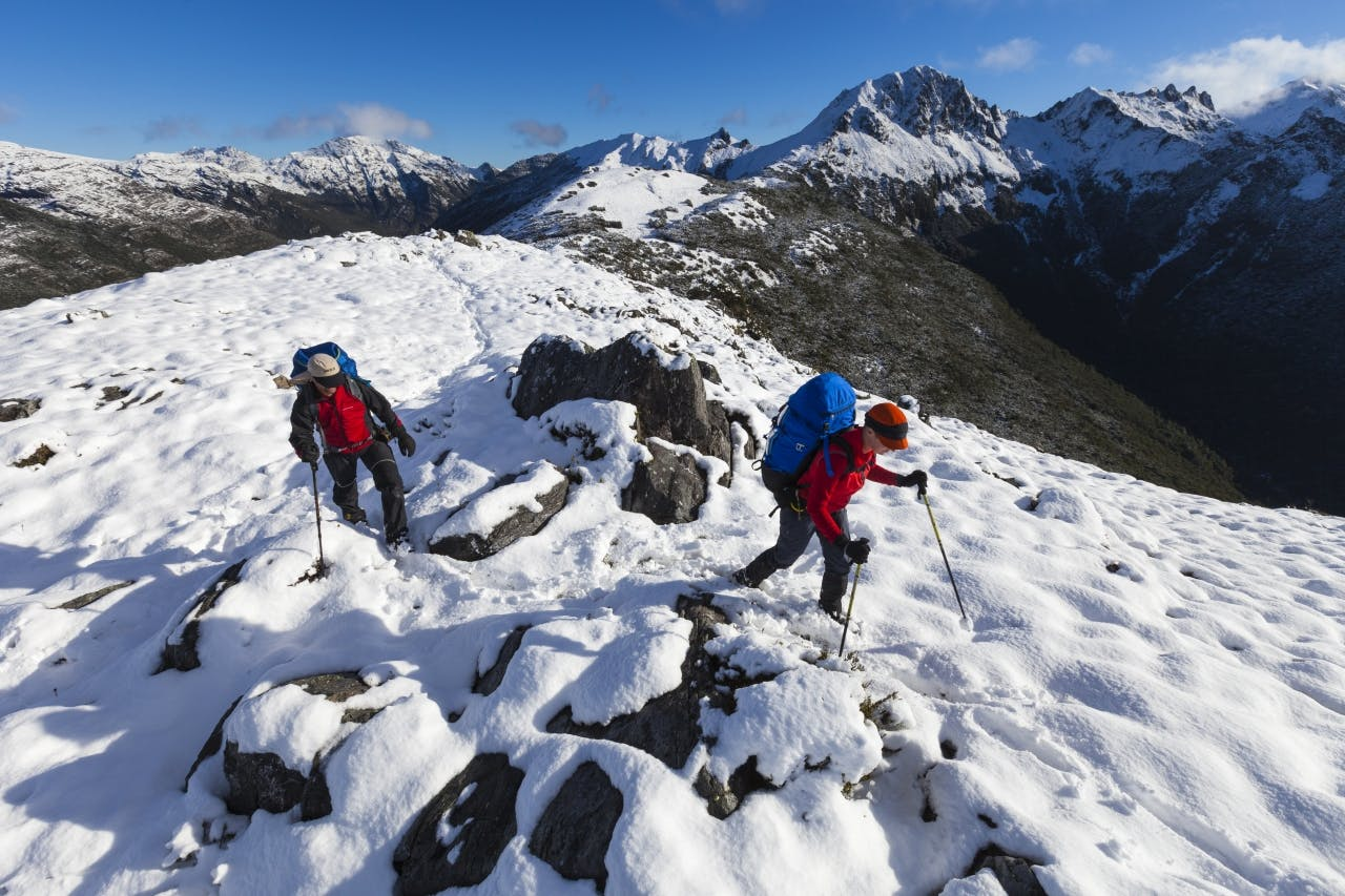 Traversing the Lockett Range after an unexpected snowfall. Waingaro Peak in background