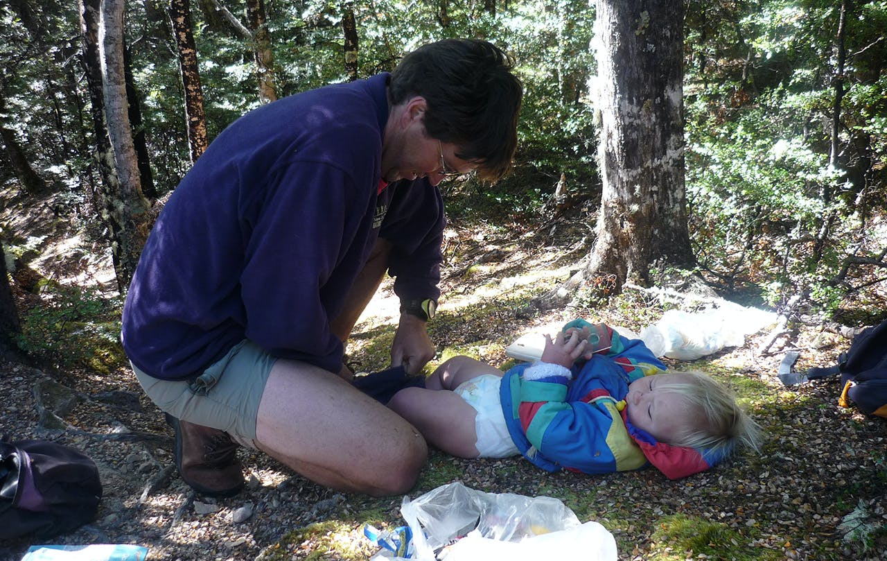 Nappy changes are an unavoidable part of tramping with babies. Photo: Margaret Carpenter