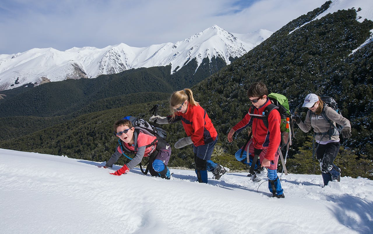 Enjoying the snow on the way up Helicopter Hill. Photo: Angus McIntosh