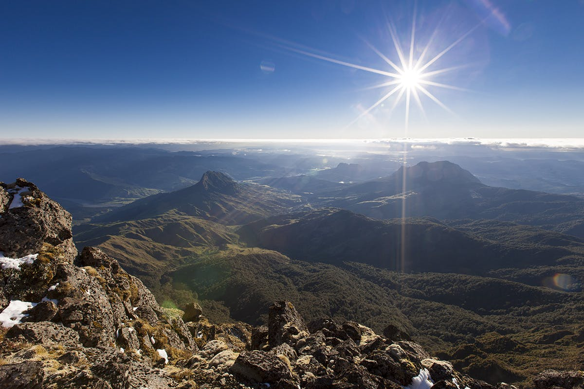 Feel the sun on your face and gain impressive views from the northern peak of Hikurangi. Photo: Mark Watson