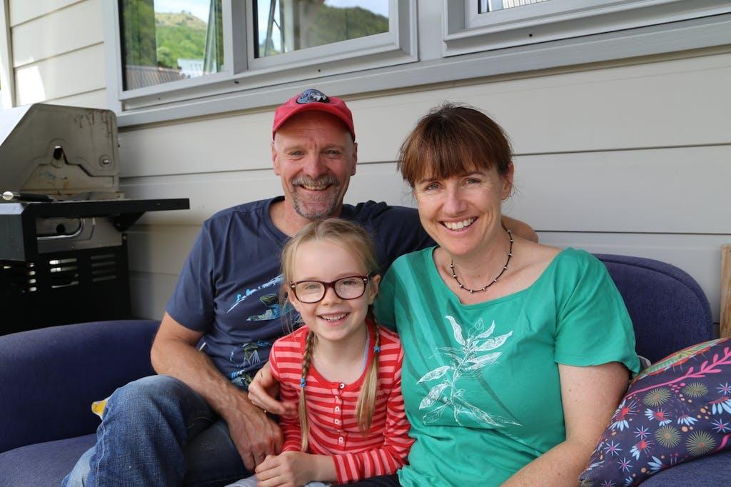 Georgie back at home with mum Lisa and dad Derek.