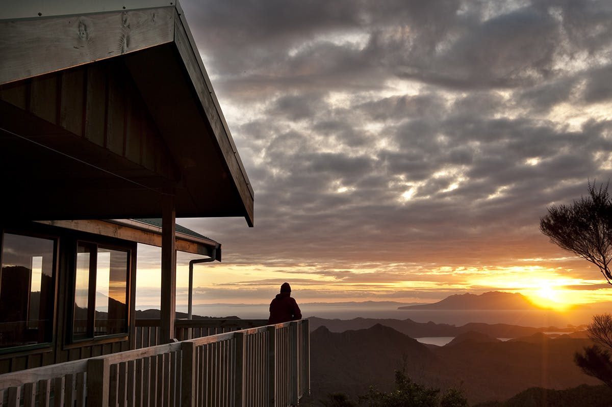 Sunset over Little Barrier Island from Mt Heale Hut. Photo: Shaun Barnett/Black Robin Photography