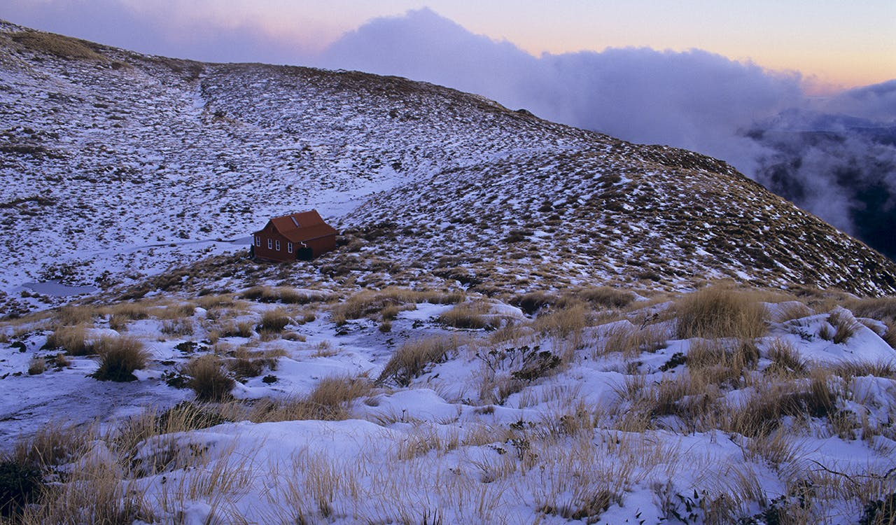 Dusk approaches at Kime Hut (Note, this hut is not eh current version of Kime Hut). Photo: Shaun Barnett/Black Robin Photography