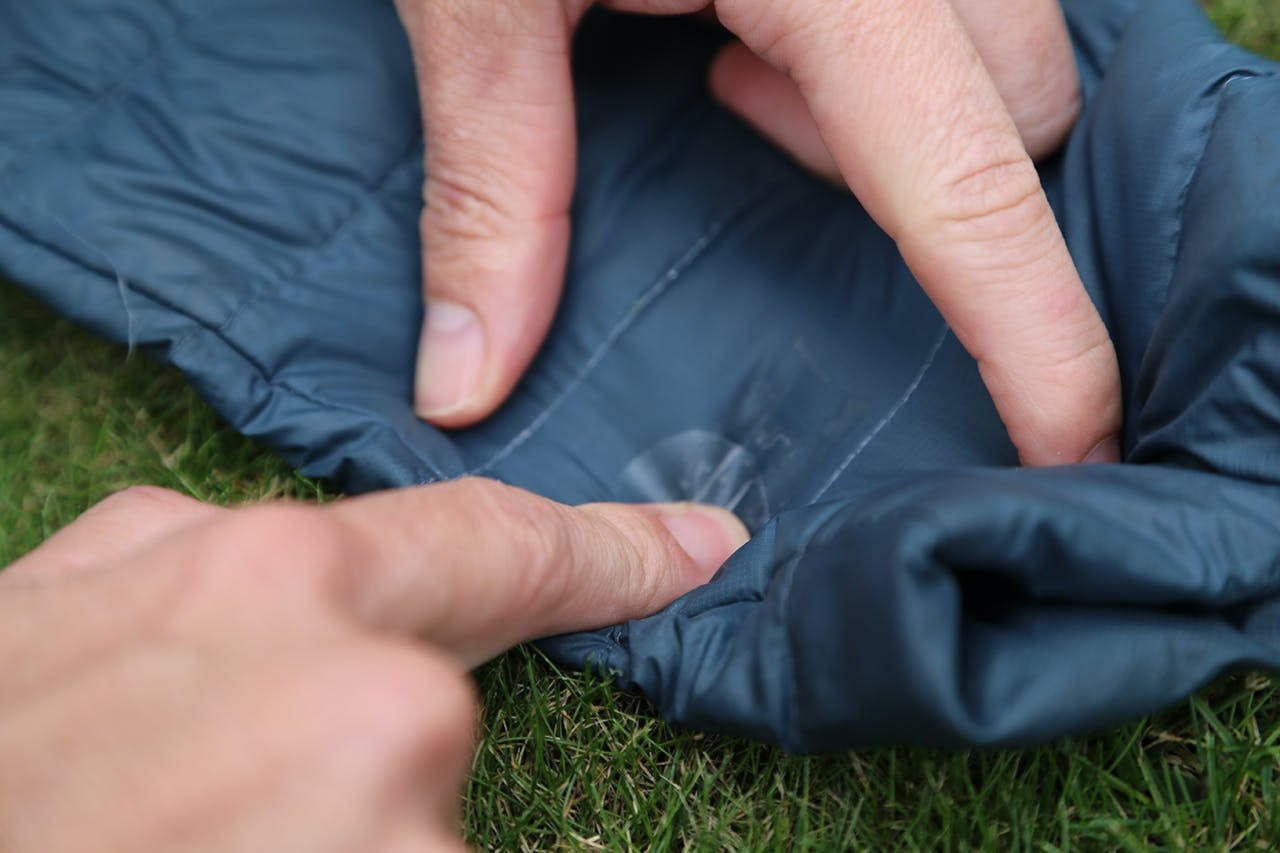 Apply Tenacious Tape patch over the hole. Photo: File