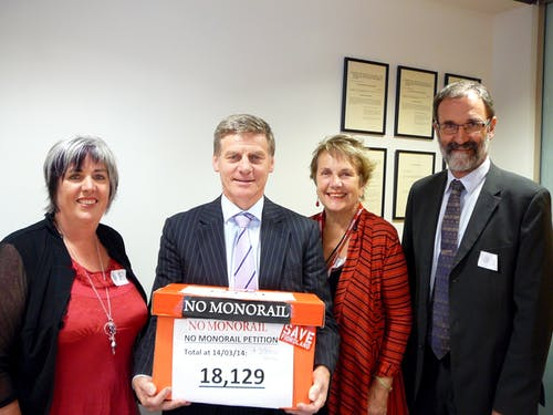 Bill English is presented with the Save Fiordland petition opposing the Fiordland monorail