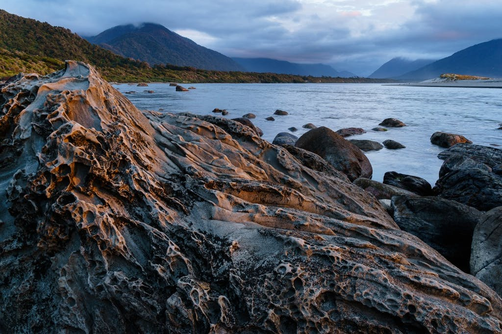 The coastal stretch ended at the Hollyford River mouth, seen here at dusk. Photo: Grant Dixon