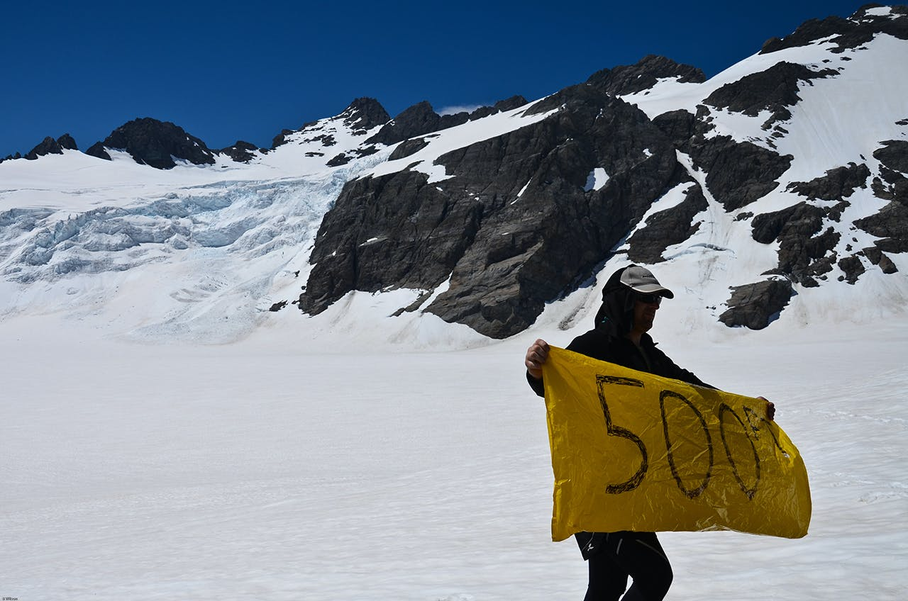 Trampers raised this sign to the helicopters on the Olivine Ice Plateau. Photo: Ben Wilson