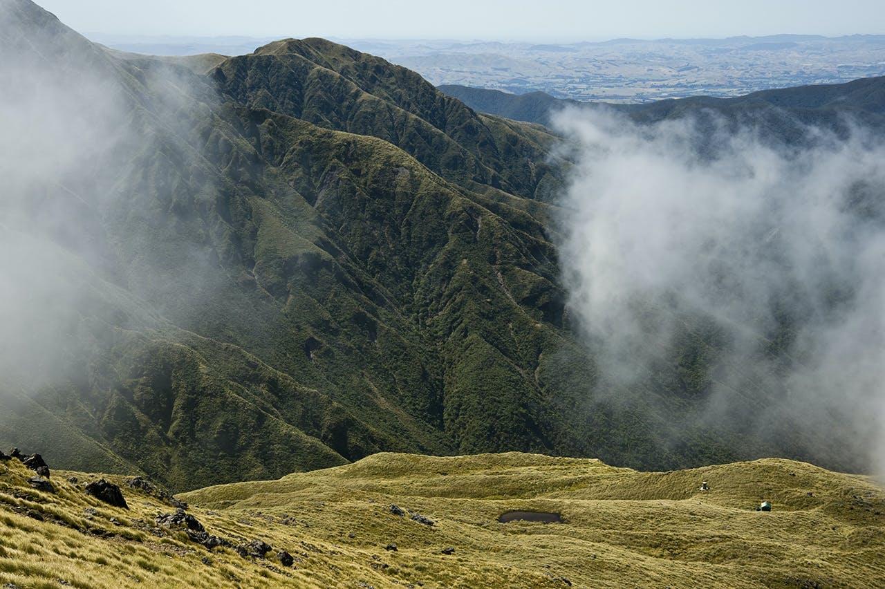 Clearing mist reveals Arete Hut. Photo: Shaun Barnett/Black Robin Photography