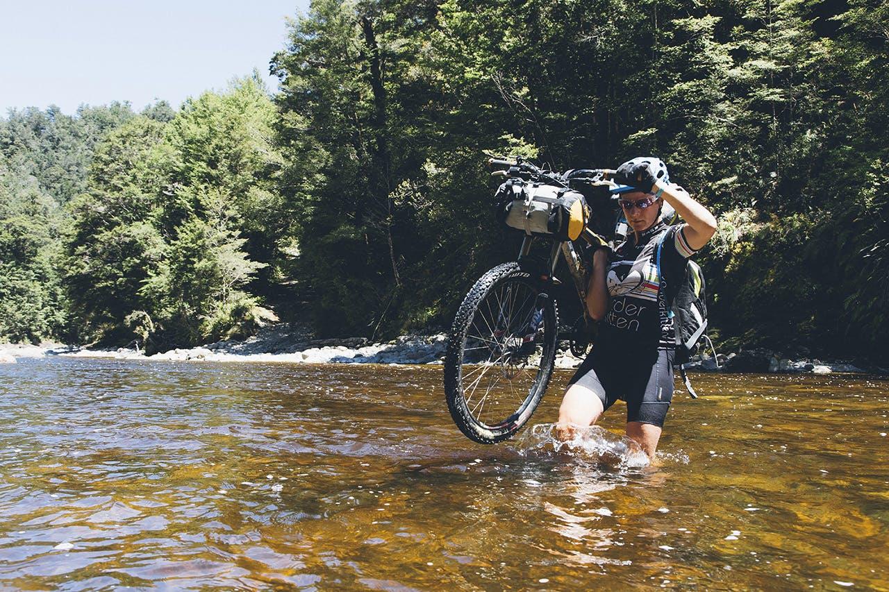 Wading the Mackey River. Photo: Mark Watson