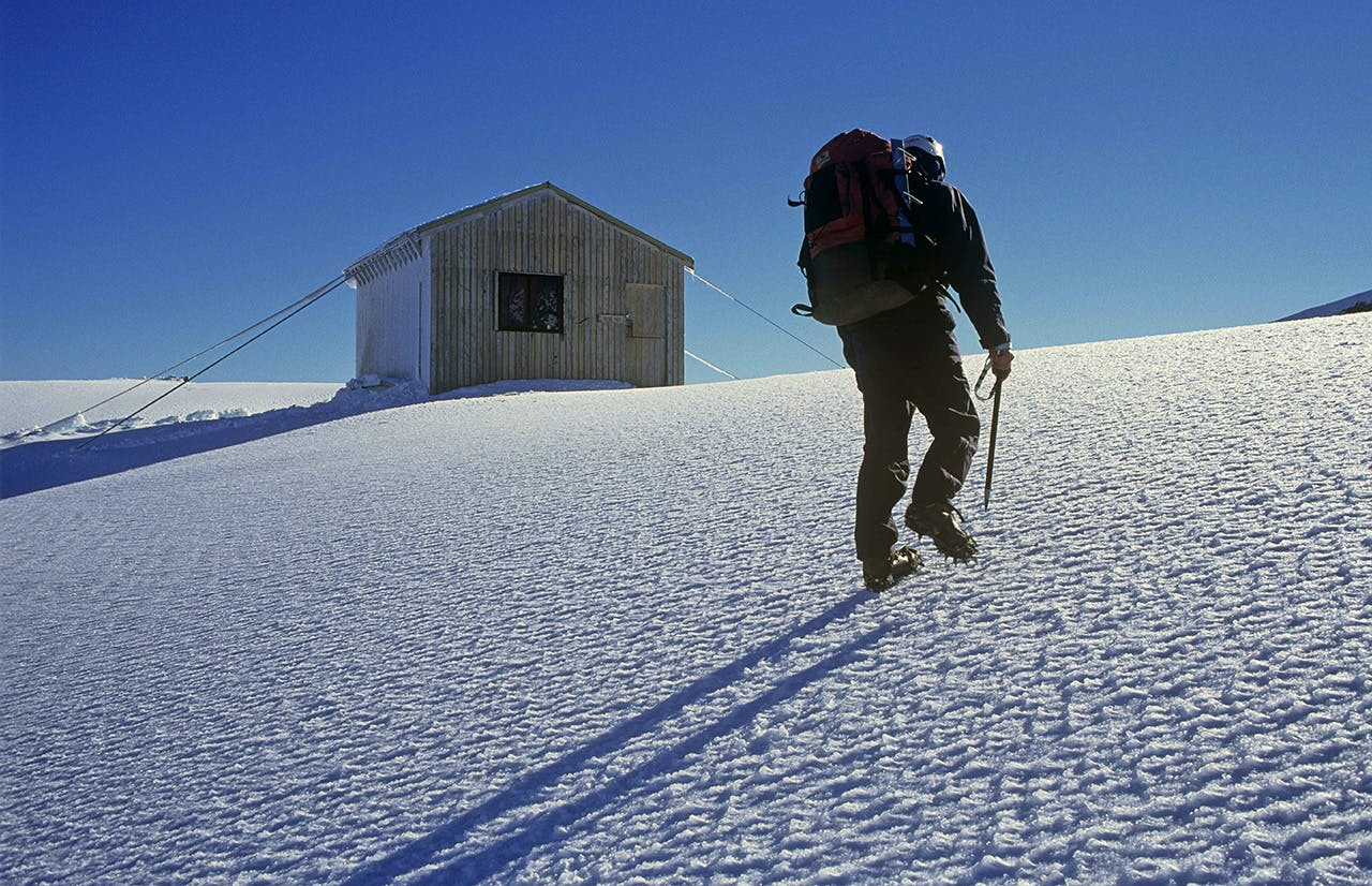 A climber approaches Syme Hut, Fantoms Peak. Photo: Shaun Barnett/Black Robin Photography