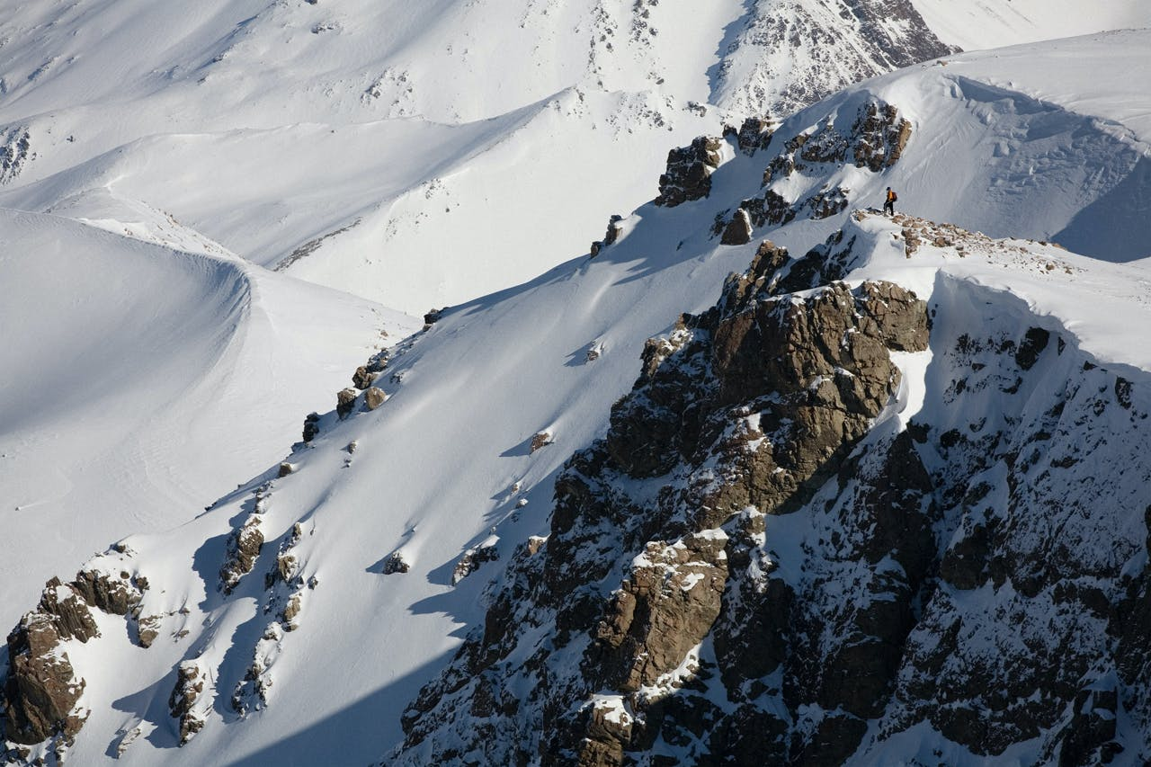 Louise Parker surveys the terrain above Dumb-bell Lake. Photo: Mark Banham