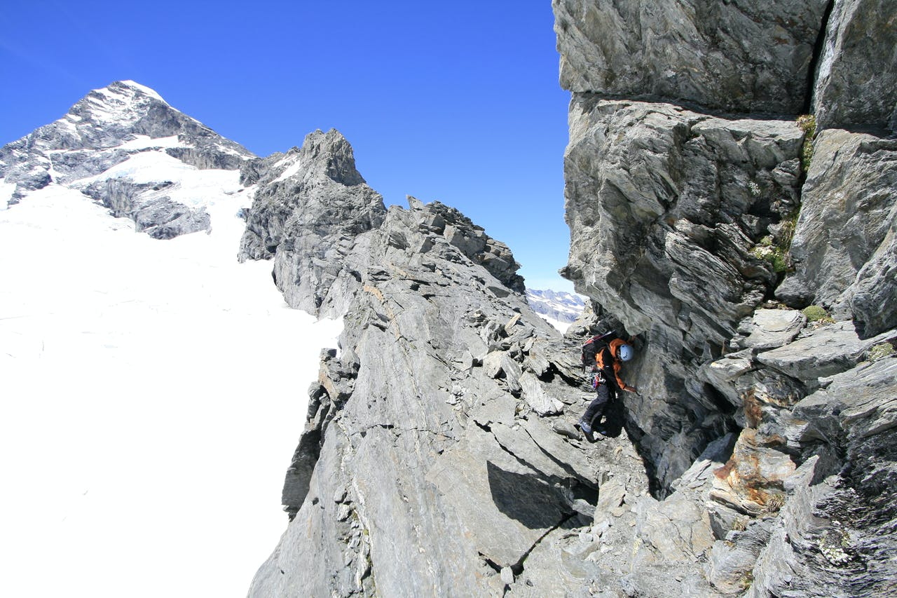 Traversing the lower section of the Aspiring's Northwest Ridge is generally considered the crux of the climb. Photo: Paul Hersey