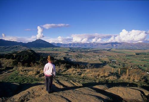 Child views Wanaka Basin from Mt Iron Wanaka