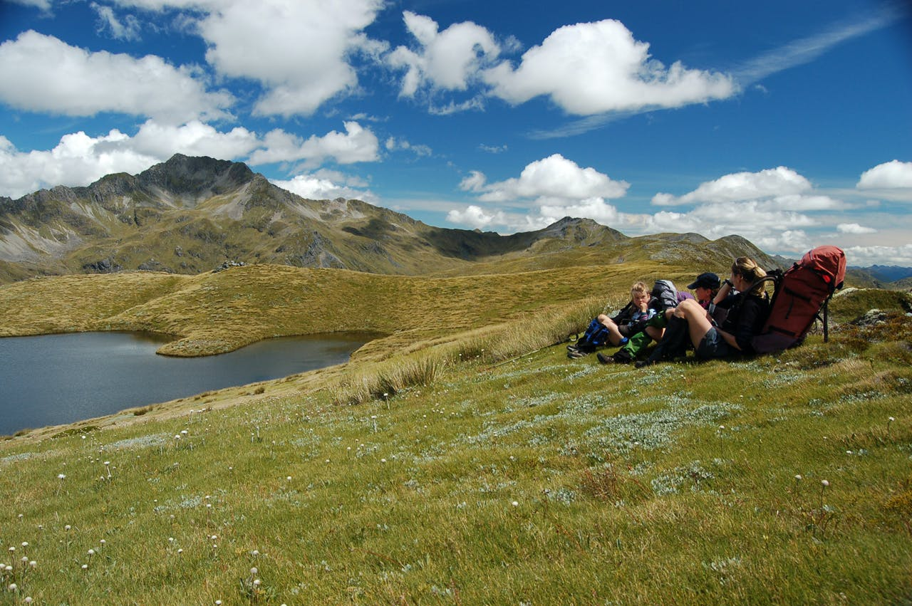 The tops here are scattered with many alpine tarns, providing great rest stops along the way. Photo: Jo Stilwell